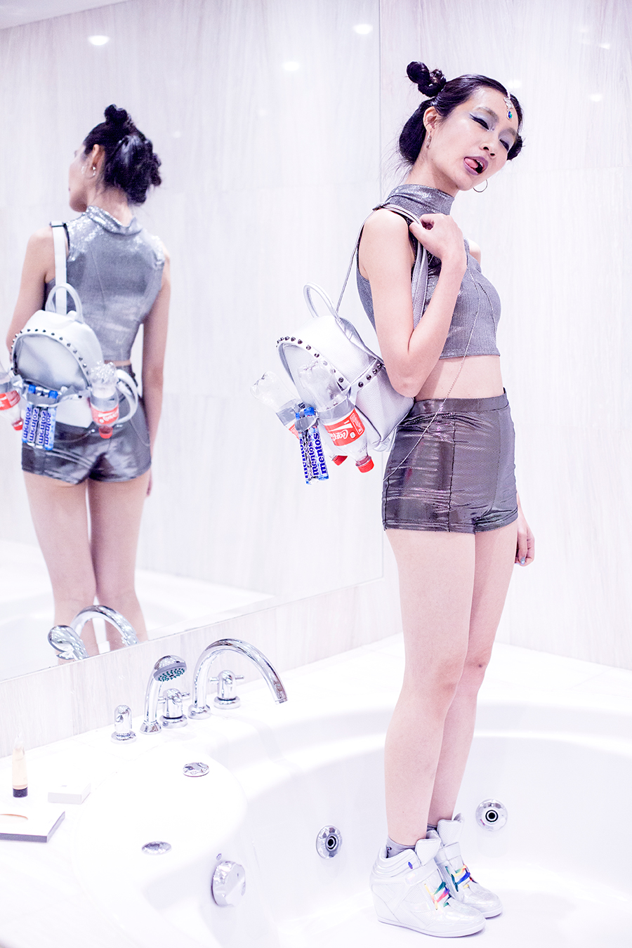 Halloween Spacesuit outfit: Topshop mystic drop hair chain, Topshop silver hoop earrings, Bugis Street silver high-collar top, Forever 21 silver shorts, Taobao grey astronaut socks, Zalora iridescent concealed wedges sneakers, Bugis Street silver studded backpack, Coca-cola bottles, Mentos sweets.