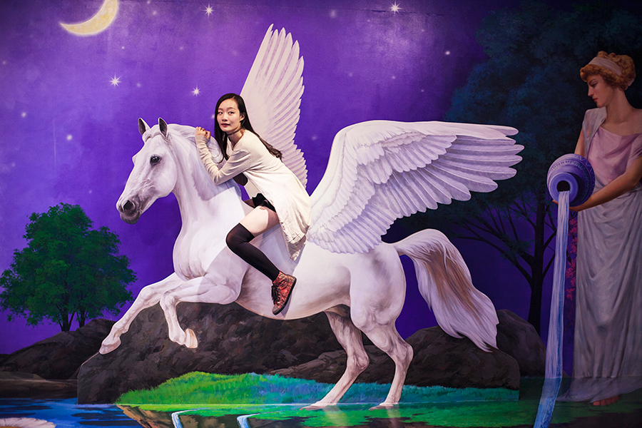 Ren riding the pegasus trompe-l'œil at the Trick Eye Museum Renewal Event in Singapore, Resorts World Sentosa.