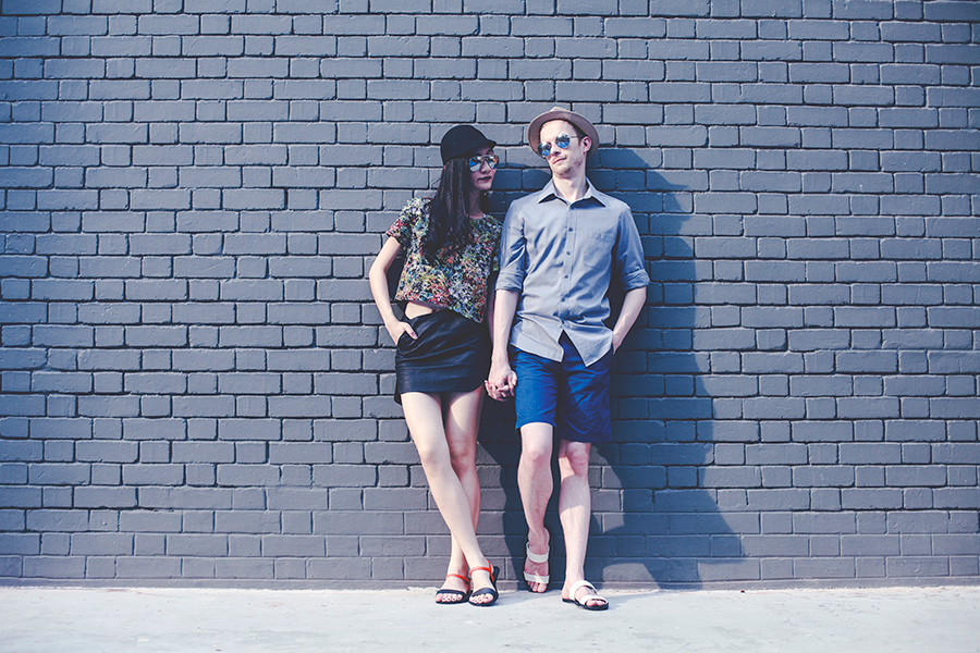 Couple modeling BlackOut sandals.