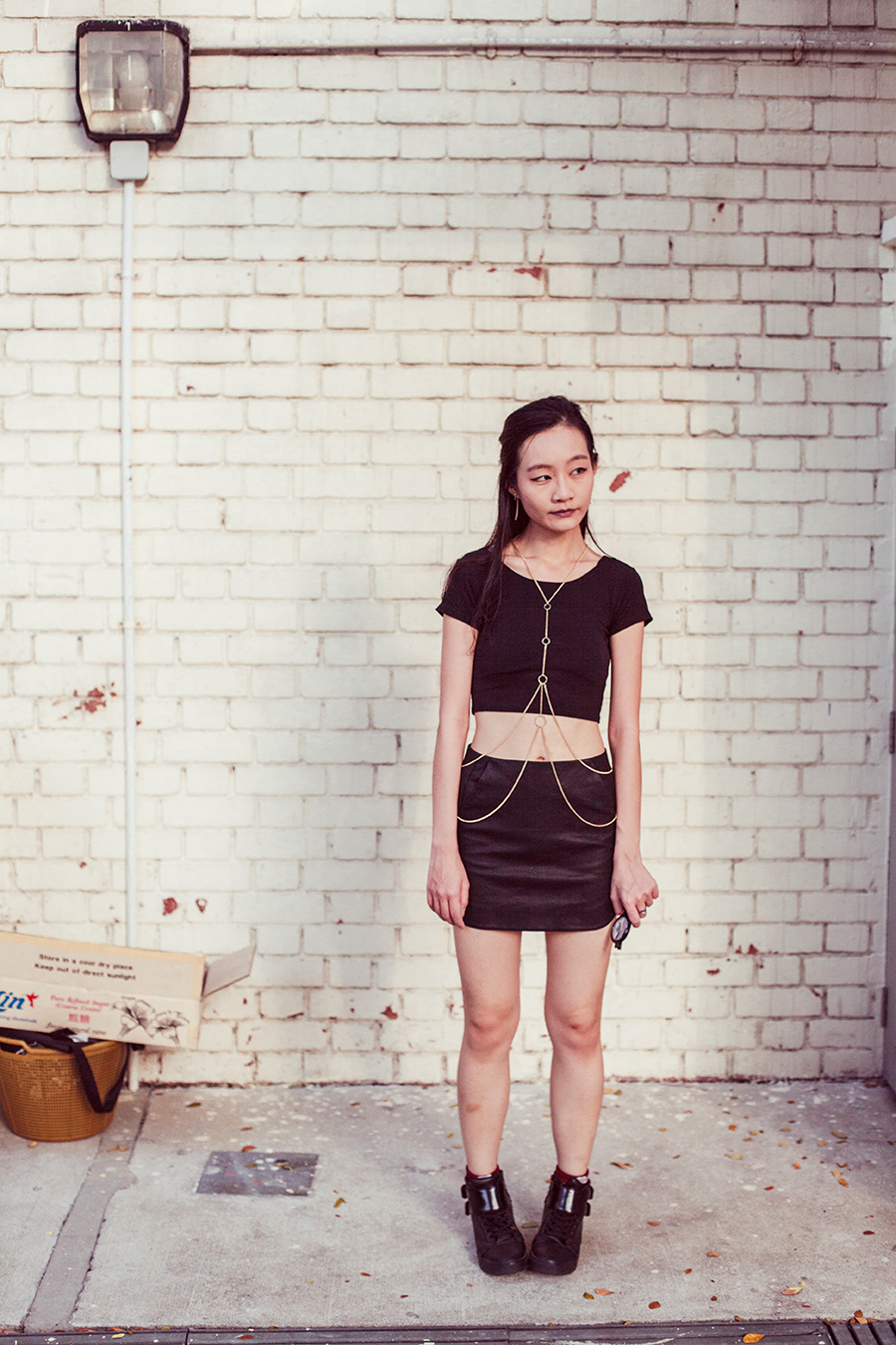 Dresslink black crop top, Topshop black mini skirt, Topshop gold bodychain, Zalora PU black high top sneakers.