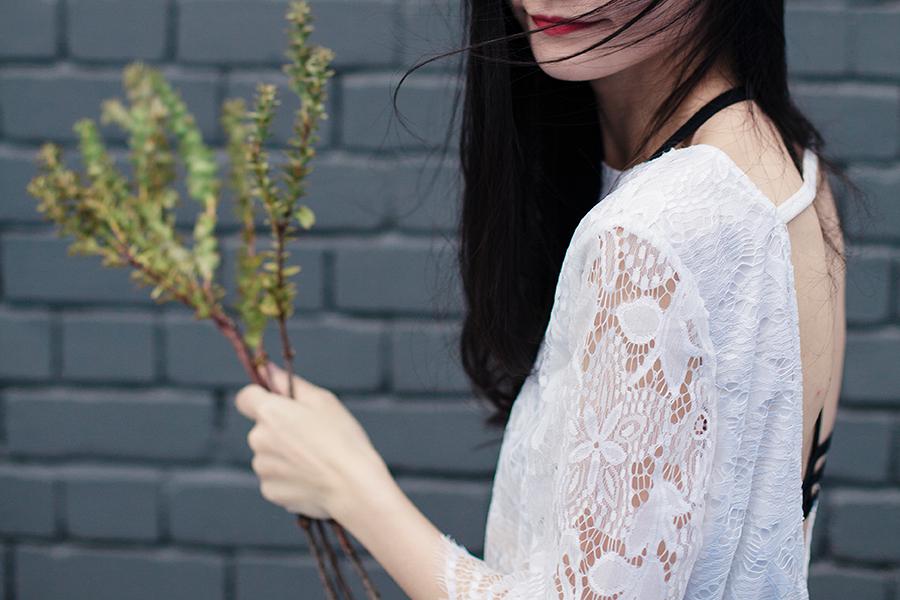 Dresslink white backless lace romper, Dresslink black strappy cutout bralette.