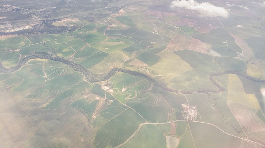 Bird's eye view of lush green fields over South Africa.