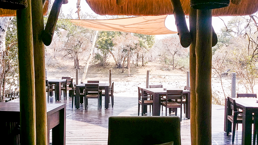 View of outdoor dining at Rhino Post Safari Lodge, Kruger National Park, South Africa.