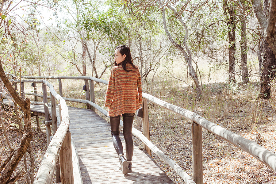 Muted black and orange knit outfit for safari, South Africa.