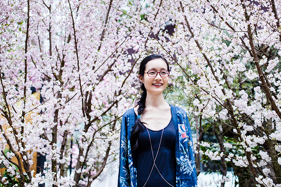 Outfit in navy among cherry blossoms in Singapore.