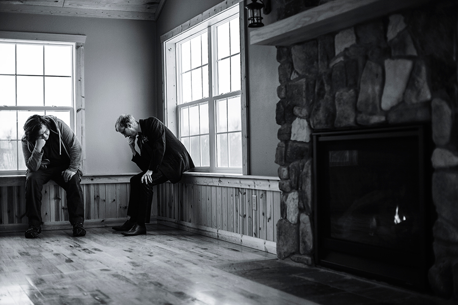 Jeff the Best Man and Groom Ottie in a Thinker stance by the fireplace.