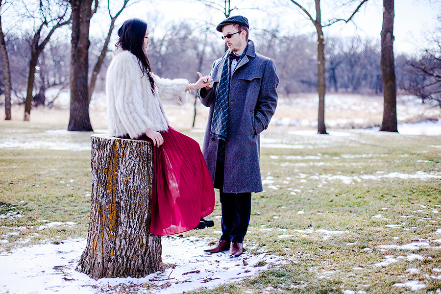Wedding photoshoot with a smatter of snow on a green field at the Rustic Oaks, Moorhead Minnesota, USA