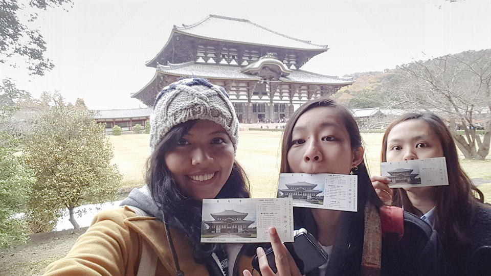 With our tickets to Todaiji at Nara Park, Japan. Photo by Shasha.