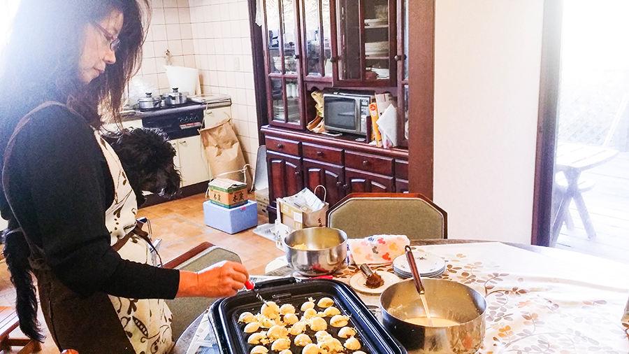 Keiko-mama starting the first batch of takoyaki at our Kyoto Airbnb.