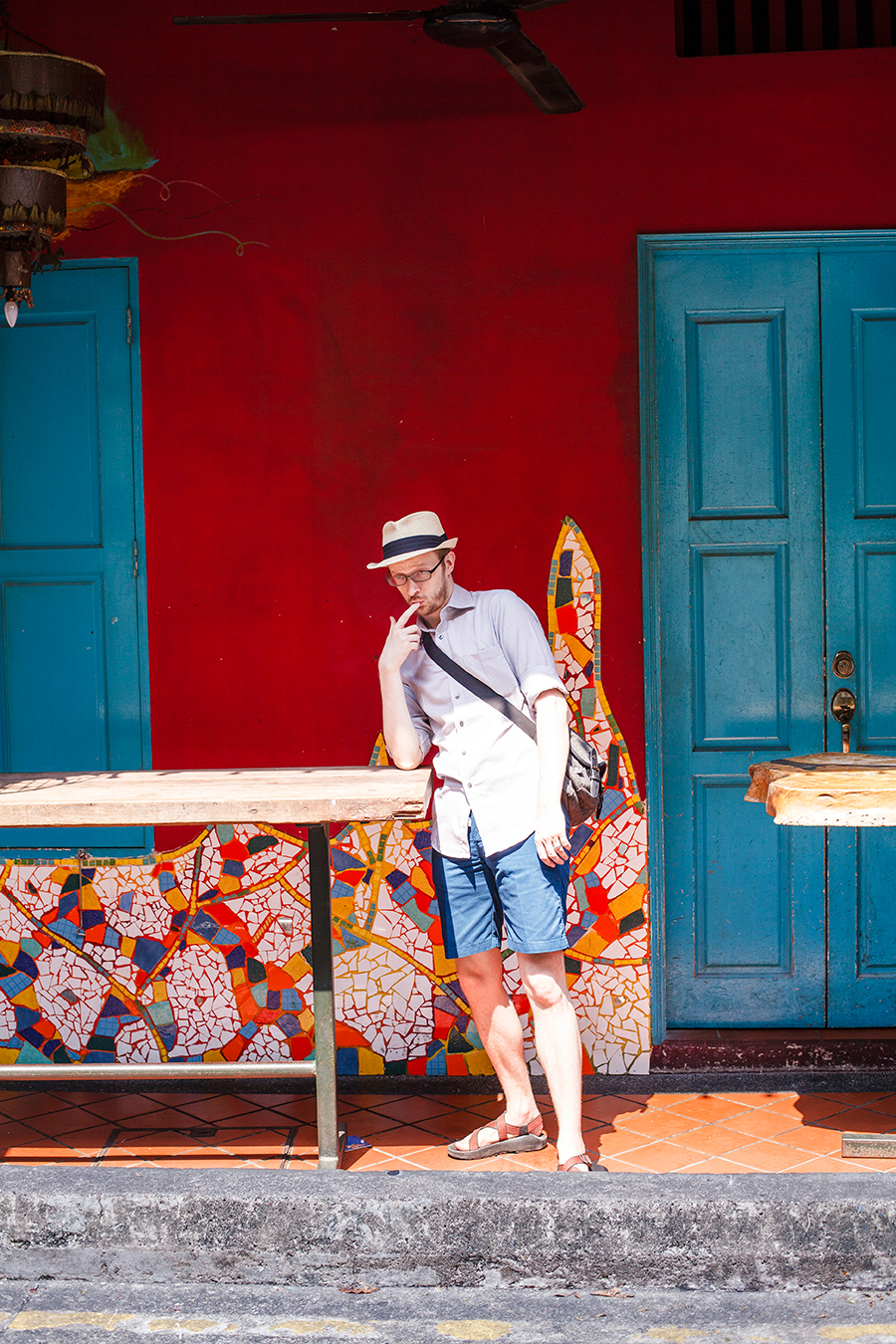 Ottie posing in front of a mosaic facade at Haji Lane, Singapore