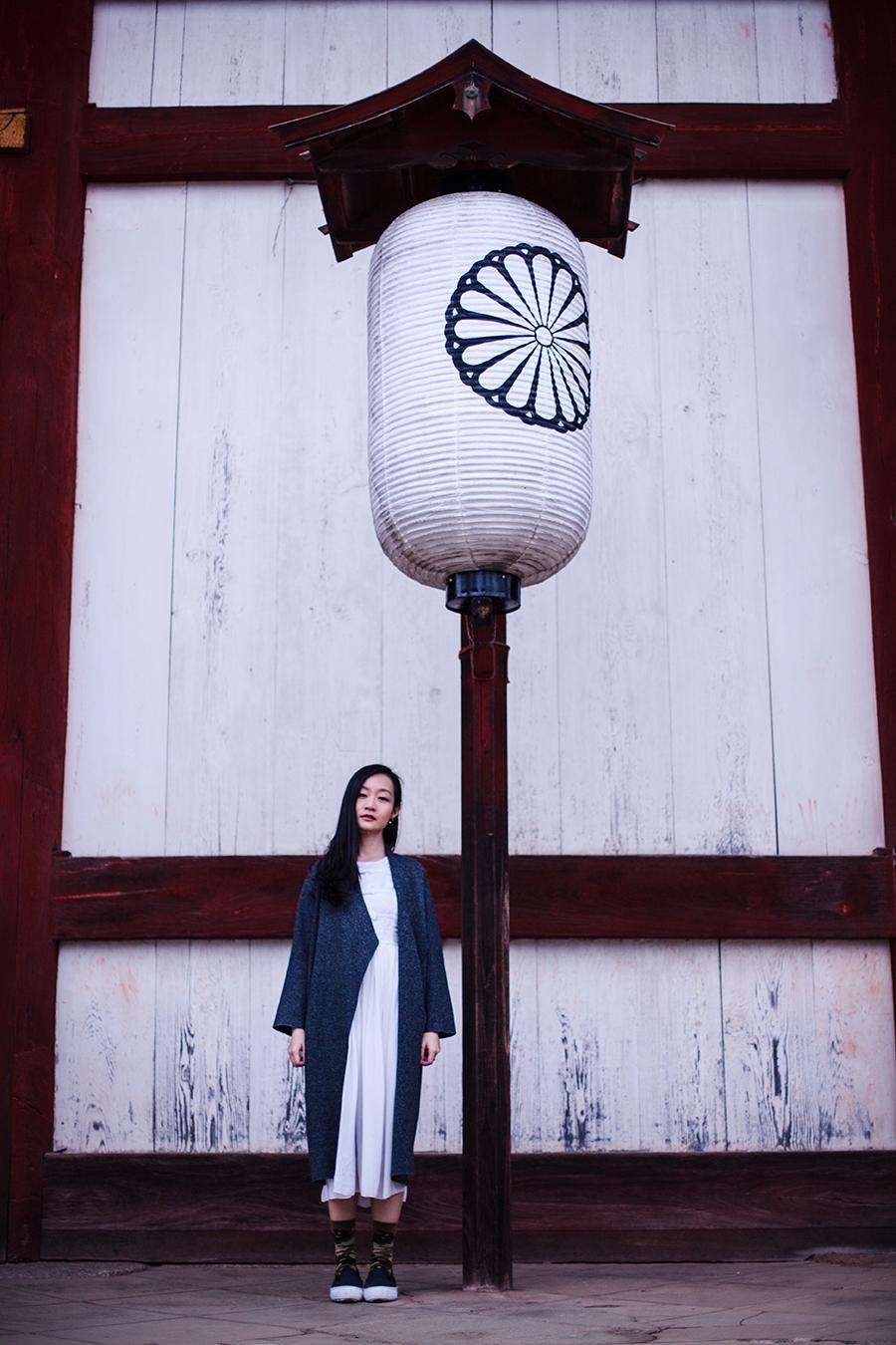 Standing next to a lantern at Todaiji at Nara Park, Japan.