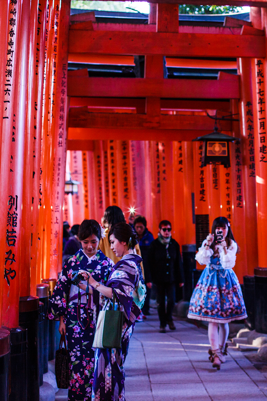 Japanese tourists at Fushimi Inari in Kyoto, Japan.