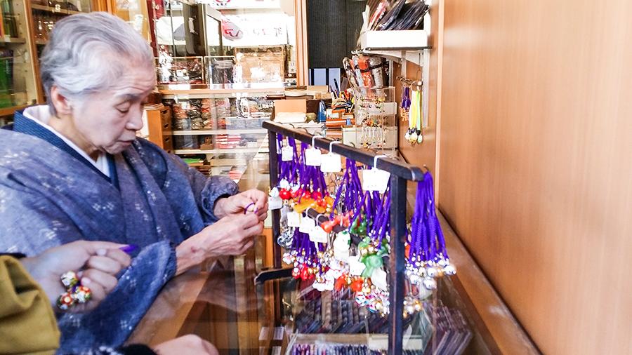 Lady proprietor selling Origami Cranes at Nakamise, Asakusa, Tokyo Japan.