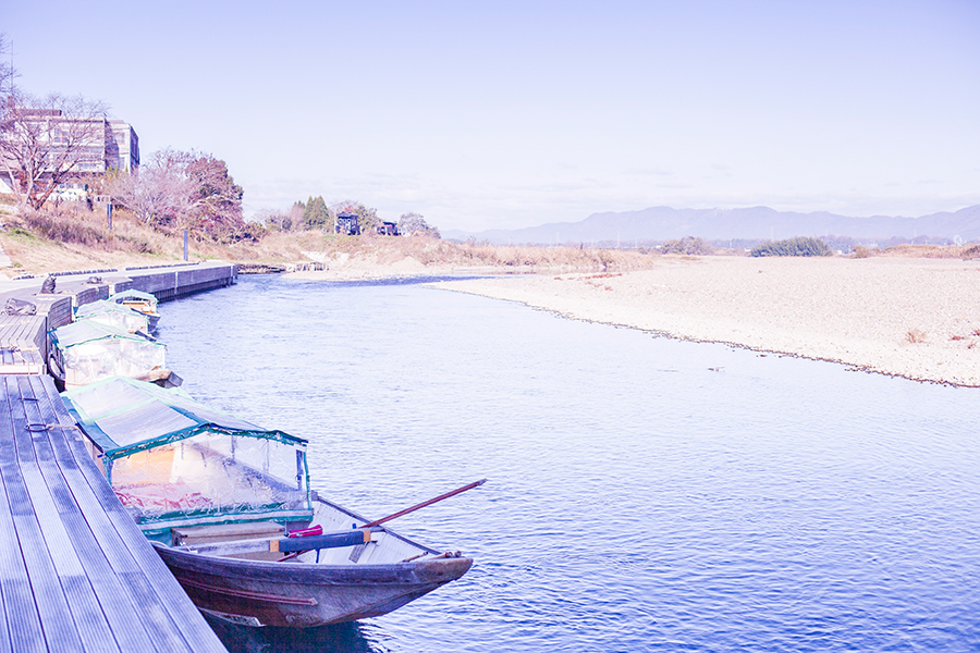 Boats lined up at Hozugawa River, Kyoto, Japan.