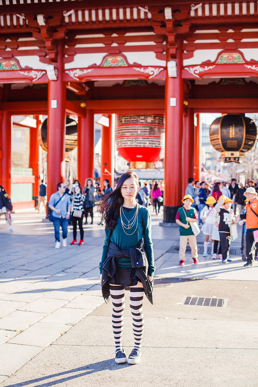 Black and white striped thigh high socks and H&M outerwear at Asakusa, Tokyo Japan.