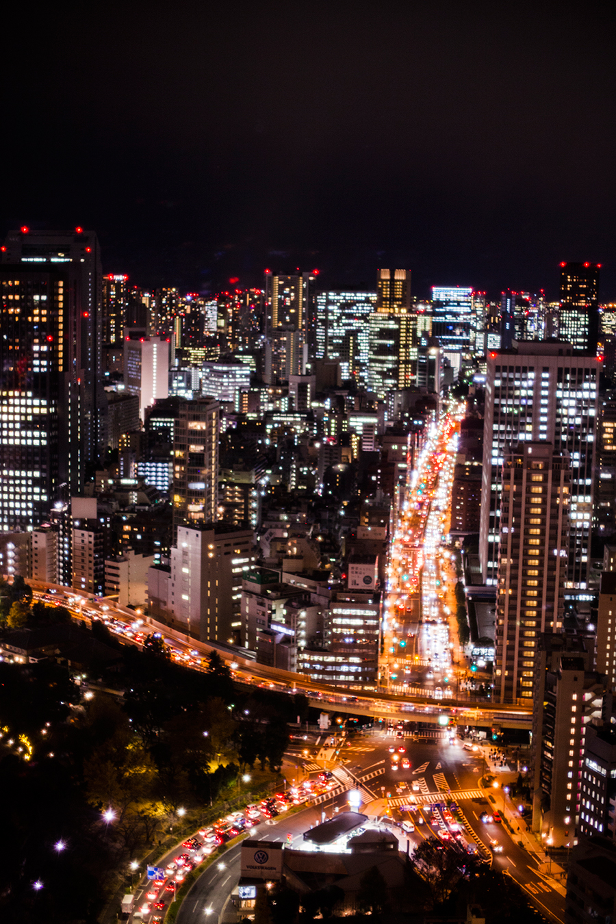 Busy roads in the night cityscape from the Tokyo Tower Observatory.