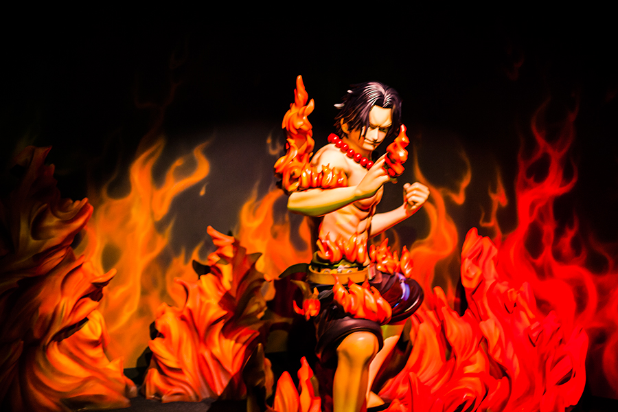 Ace burning in fire at One Piece Tower, Tokyo Tower Japan.