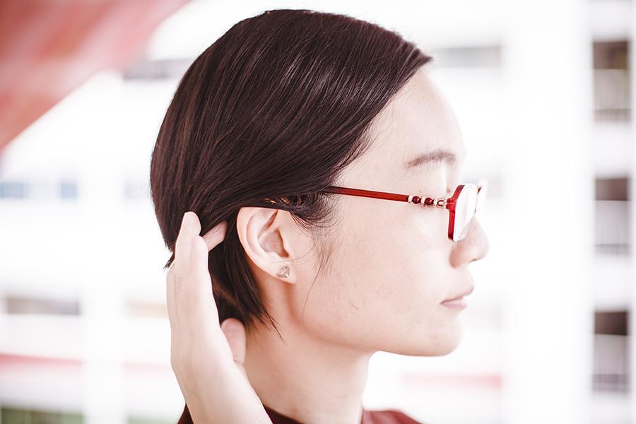 Triangle ear stud.