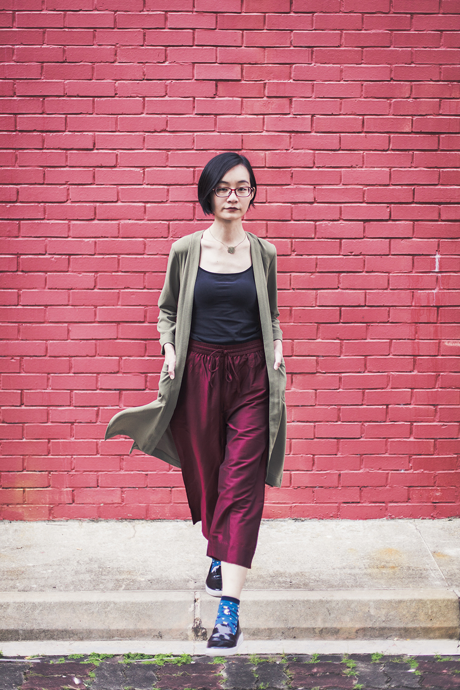 RGB outfit: H&M olive green trench coat, Max oxblood crop pants, Uniqlo black bratop, Don Quijote blue tabi socks, Zalora black patent shoes, Firmoo red glasses.