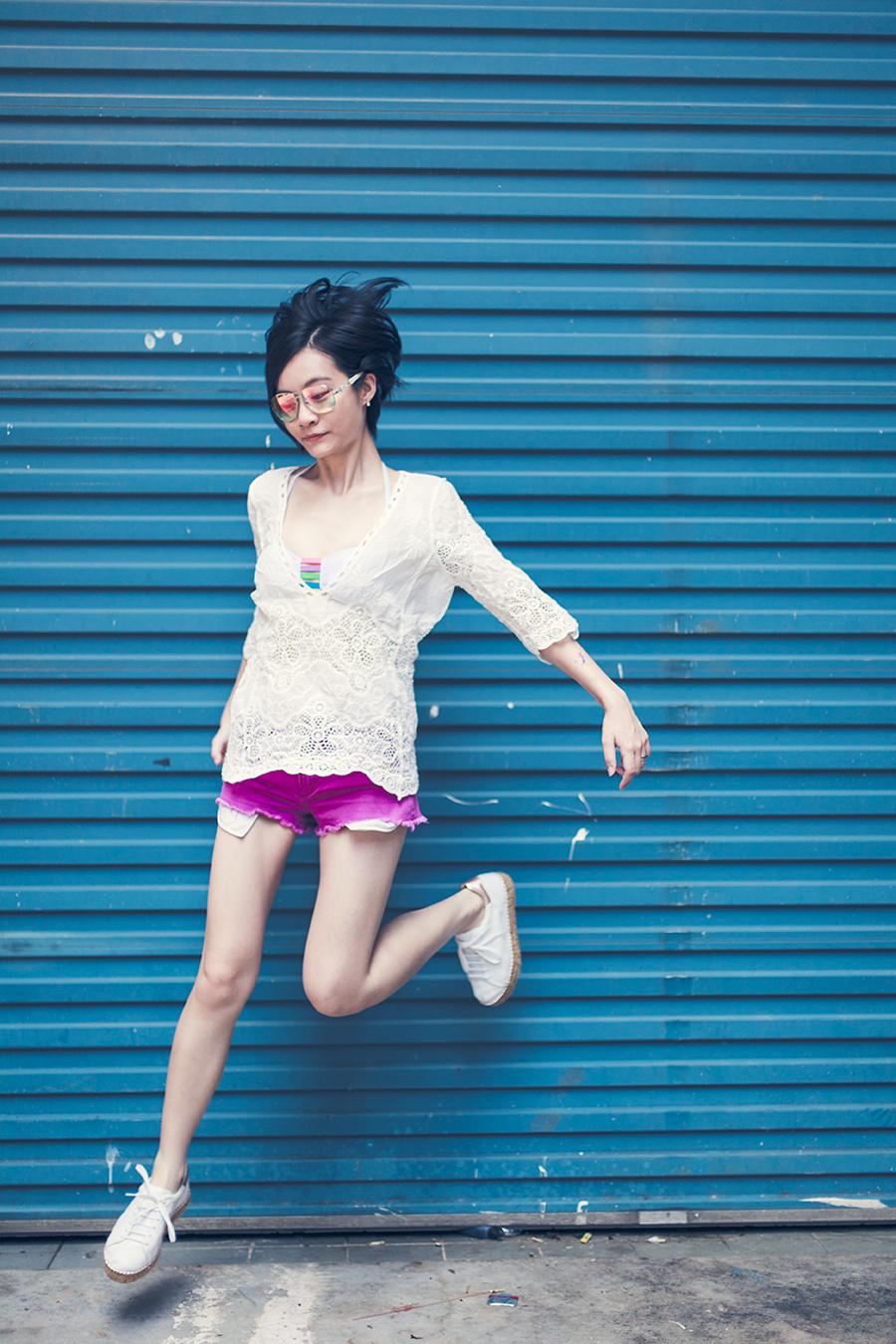 Casual Swimwear ootd: BikiniBeachwearStore Relleciga Cherry Bikini top, Shein white pullover, Forever 21 pink denim shorts, Guess iridescent sunglasses, KG Kurt Geiger Lovebug sneakers.