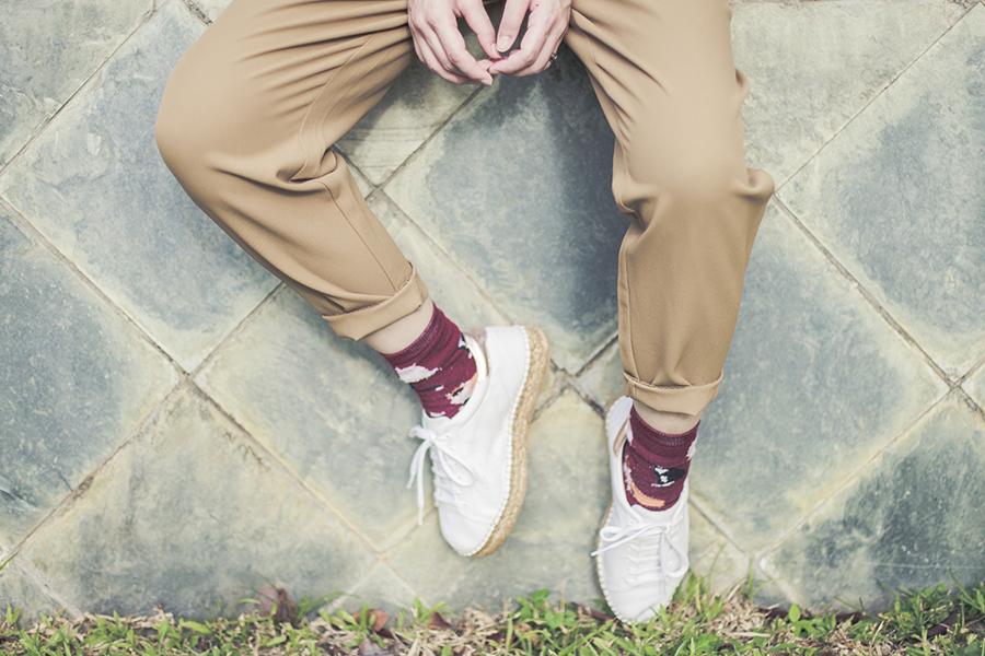 Neutral work outfit: GU pants, Kurt Geiger Lovebug sneakers, Magenta kitty socks.