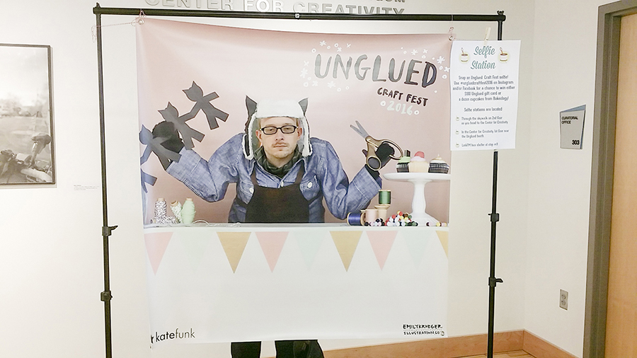 Ottie posing behind a selfie station at Unglued craft fest