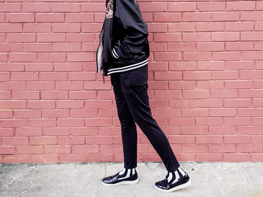 Monochrome B&W outfit: Rocket x Lunch reversible bomber jacket, Uniqlo black bratop, WholesaleBuying harem pants, Sammy Icon b&w striped socks, Zalora slip-on shoes.