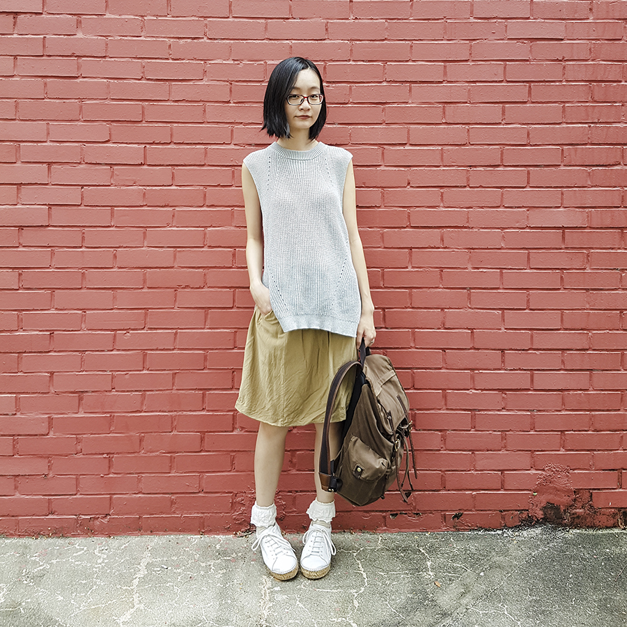 Neutral Minimalist Style: Uniqlo oversized knit vest, Zara skirt, Tutuanna socks, Kurt Geiger Lovebug leather sneakers, Fossil backpack, Firmoo red glasses, Cirkus Charms silver triangle earrings.