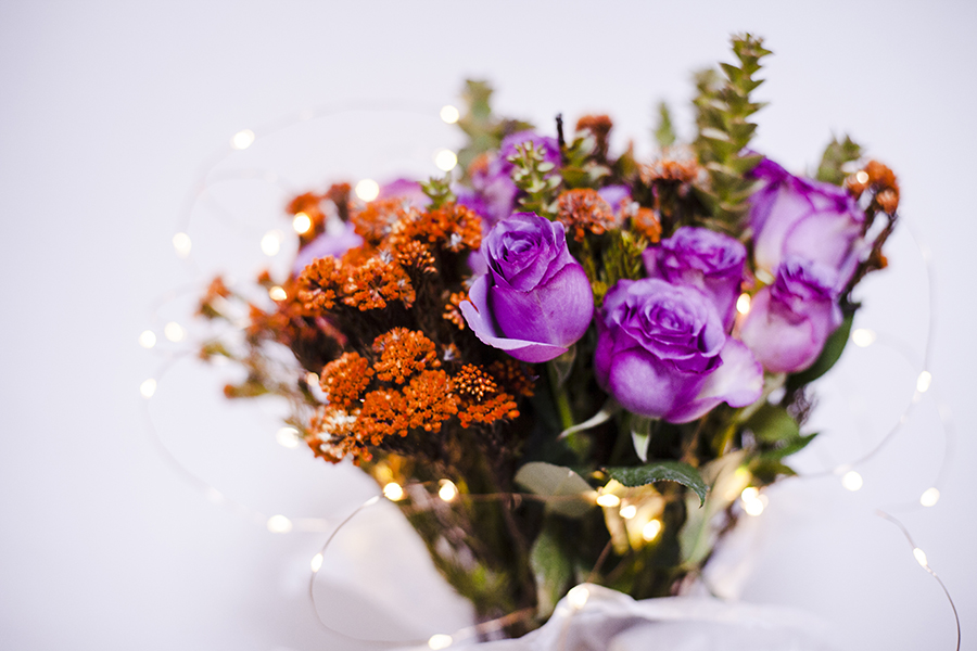 Christmas bouquet for the husband: Purple roses, orange Metalasia, Paranormus. Copper lights from Dresslily.