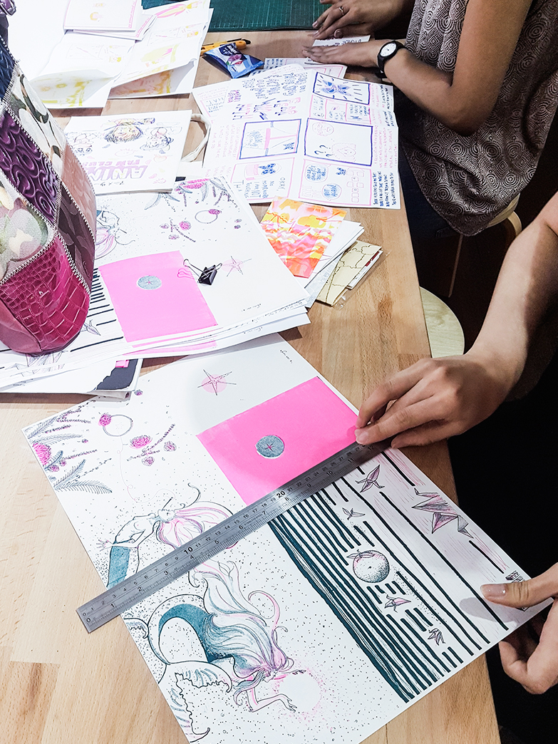 Scoring the 2-colour risograph zine at Knuckles & Notch studio, Singapore.