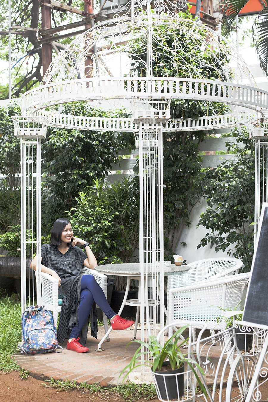 Shasha lounging at the garden pavillion at The Brew Room, Chennai India.