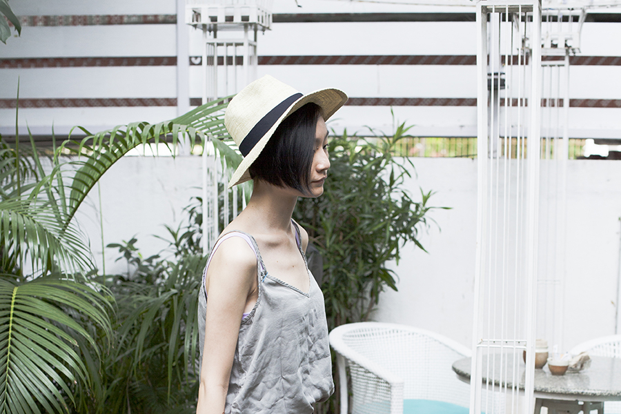 Shopping in India outfit: Cotton On top, Uniqlo UV straw hat.