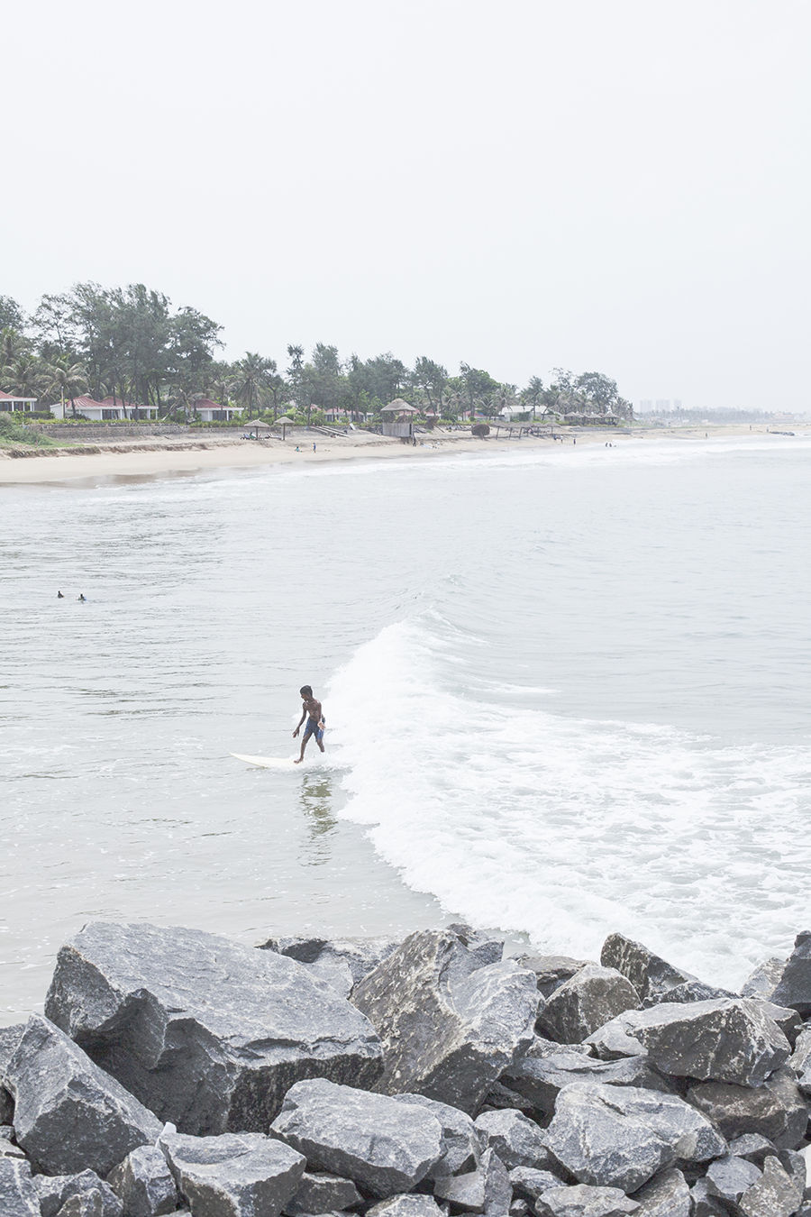 Boy riding the wave in Chennai India.