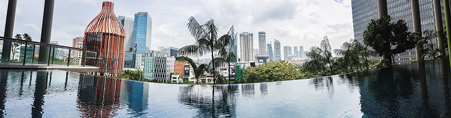 Panorama of infinity pool at the level 5 wellness floor at hotel PARKROYAL on Pickering, Singapore.