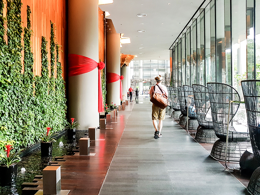 Ottie walking down the main lobby of PARKROYAL on Pickering hotel, Singapore.