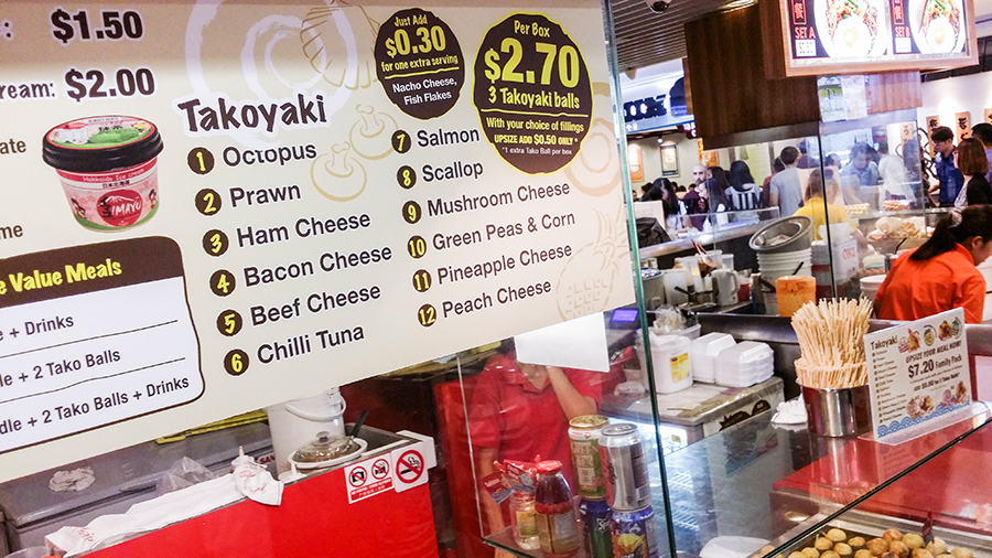 Takoyaki menu at a stall in Singapore.