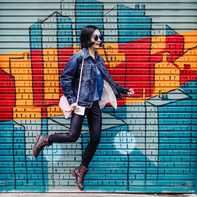 Denim leather outfit in front of a mural in Perth Australia.