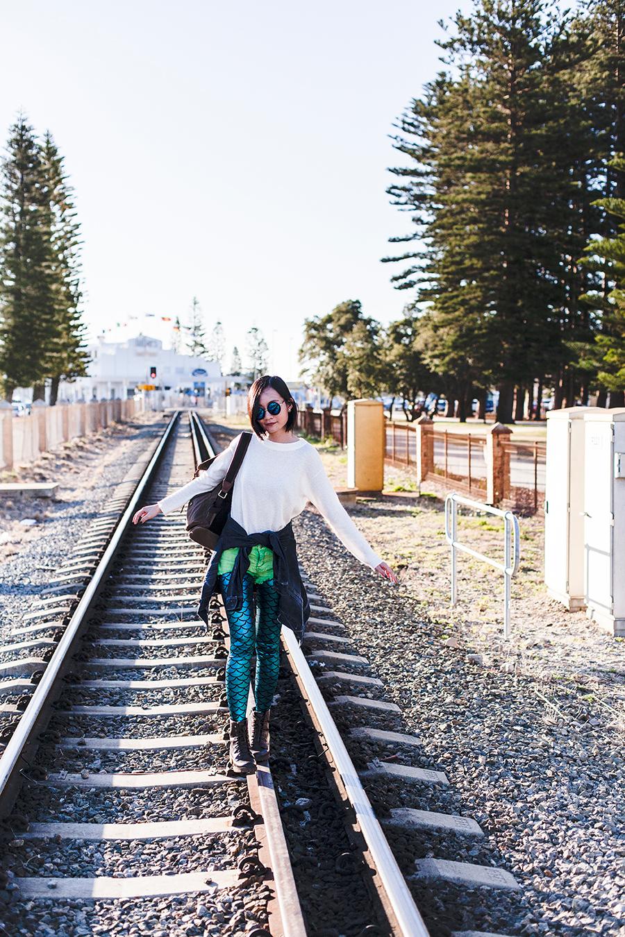 Railroad outfit: GU white knit sweater, Forever 21 green crop denim shorts, mermaid shimmer leggings, Blend denim jacket, Fossil backpack, Steve Madden boots.