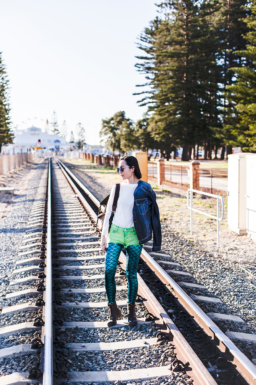 Railroad outfit: GU white knit sweater, Forever 21 green crop denim shorts, mermaid shimmer leggings, Blend denim jacket, Fossil backpack, Steve Madden boots.