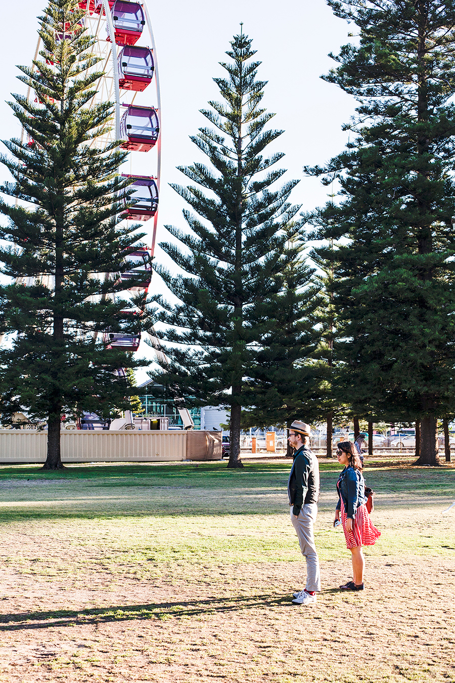 Artistic photo in front of a ferris wheel in Fremantle Perth Australia.