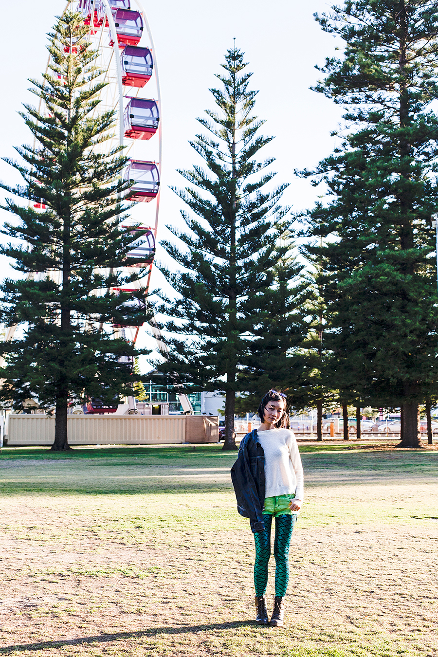 Outfit in front of a ferris wheel in Fremantle Australia.