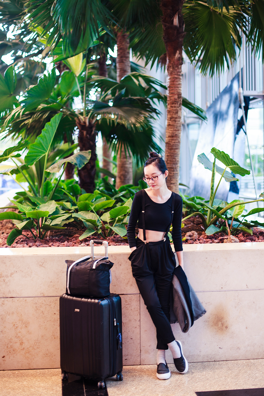 Black monochrome outfit for traveling: Dresslink black crop top, WholeSaleBuying black harem pants, Spurr shoes, Gap black framed glasses.