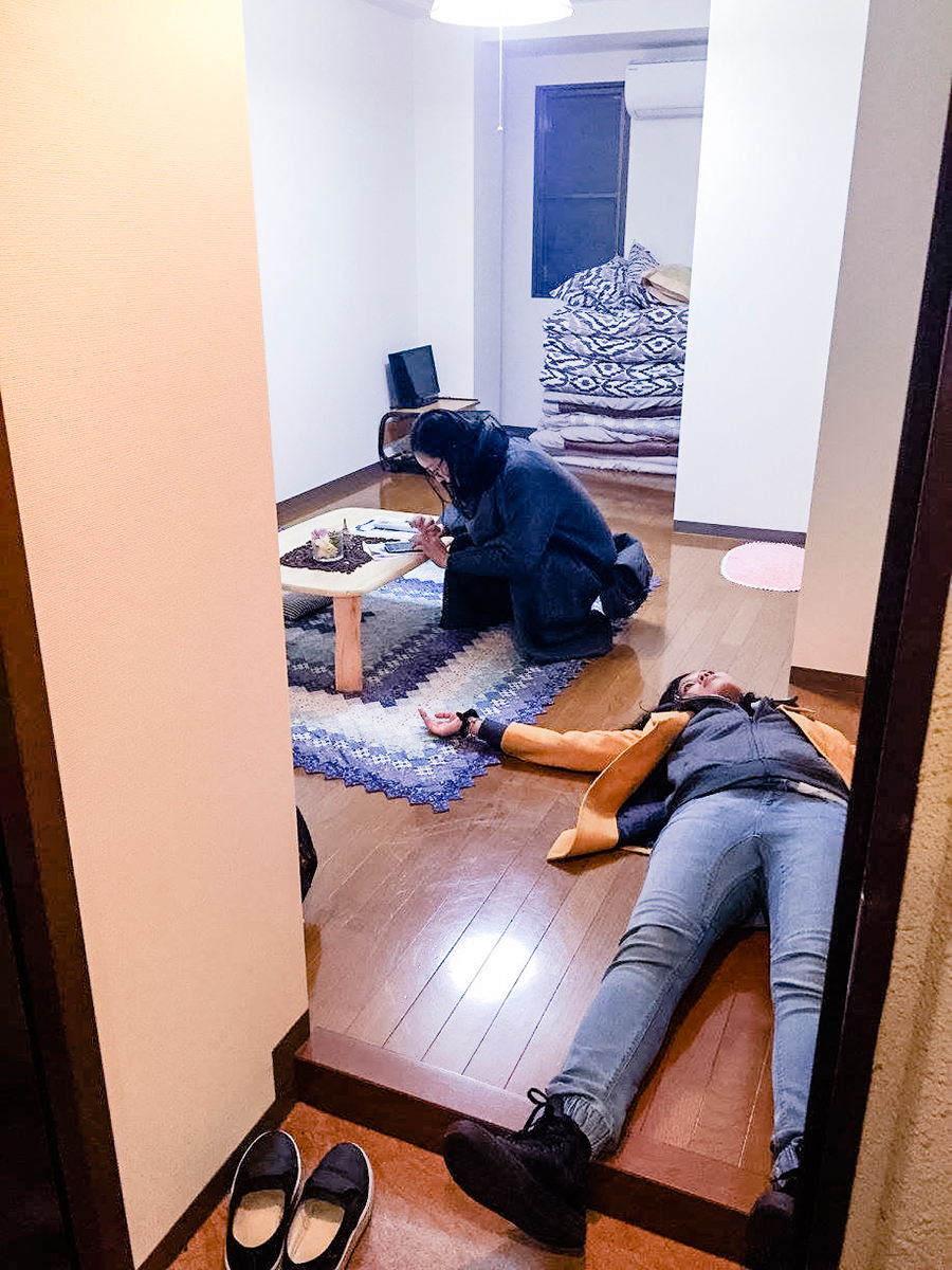 Dead tired upon reaching our Airbnb in Osaka, Japan. Photo by Ruru.