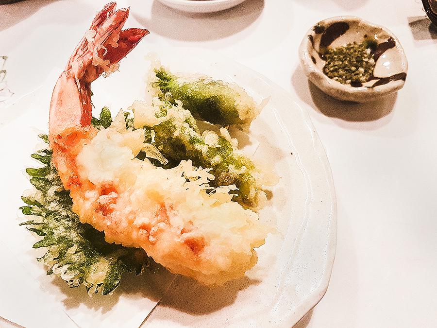 Shrimp tempura, shiso leaf, seasoned vegetable, and seasalt in Makoto Sushi.