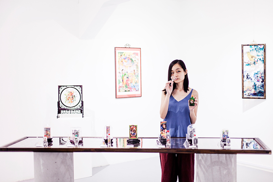 Smelling perfumes at Mojoko and Terry Jacobson 'Sick Scents' exhibition at Chan + Hori Contemporary, Singapore.