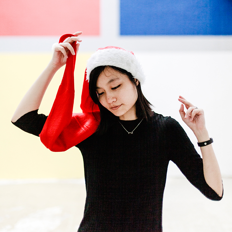 Extra long santa hat and a little black dress for christmas 2017.