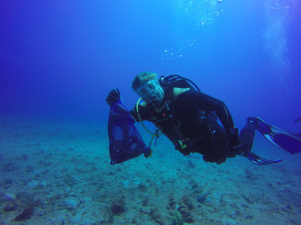 SCUBA diver removes trash and debris from Palm Beach's reef during underwater cleanup