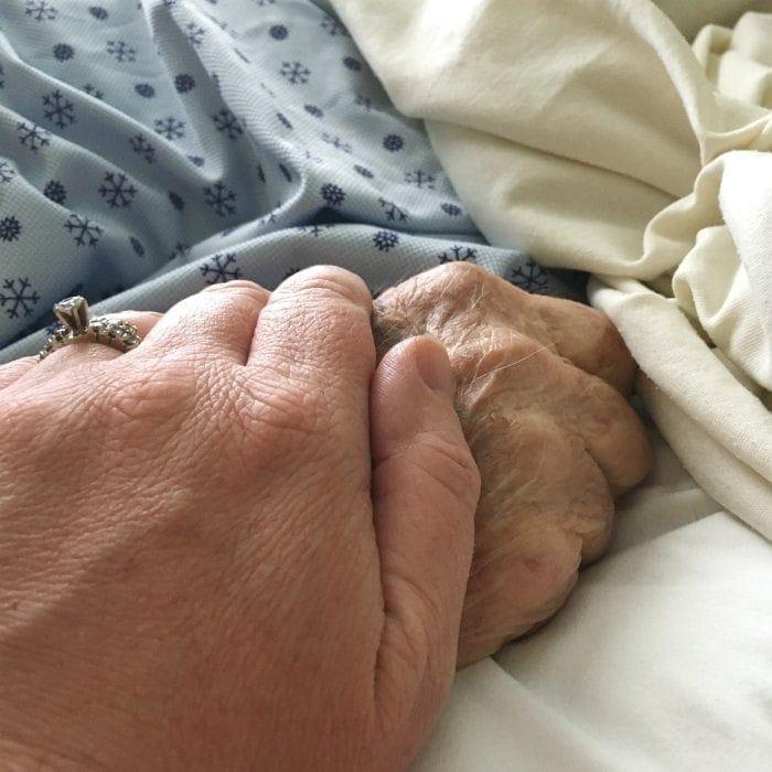Holding grandpa's hand as he passed away