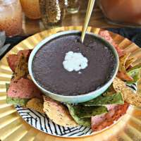This traditional Costa Rican black bean dip recipe is the perfect party food. Vegetarian, vegan and perfect for dipping plantain chips, tortilla chips, or making seven layer dip, you will love how easy this black bean dip recipe is to make!