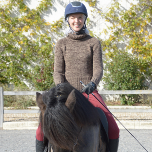 Lara Bonner riding her horse at Pur Cheval